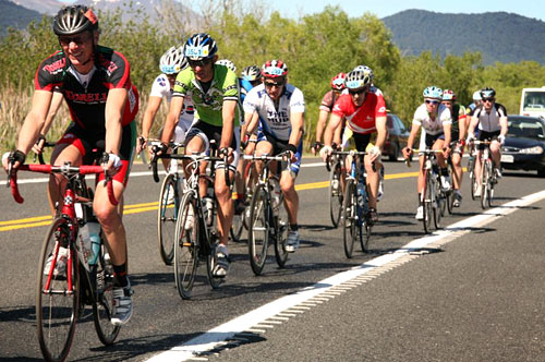 Exhausted Cyclists on the Lake Taupo Cycle Challenge