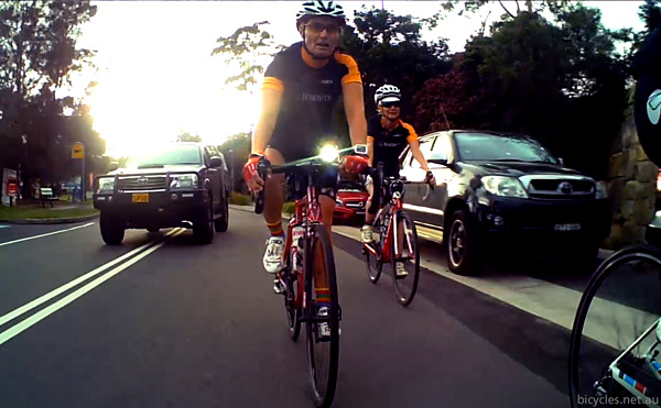 Car behind cyclists